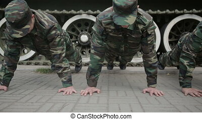 Soldiers doing push-ups - Russian soldiers are pressed on...