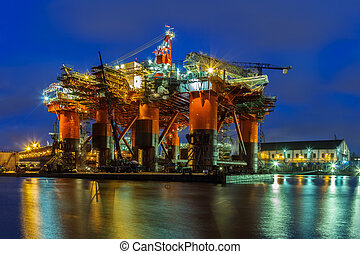 Oil Rig at night - Oil Rig in the shipyard for maintenance...