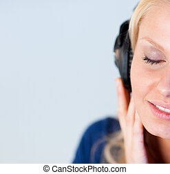 Relaxed woman listening music with headphones - Relaxed...