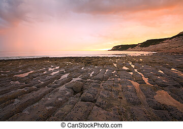 Seascape, Hastings - Beach rock formations at low tide near...