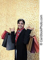 Beautiful Indian woman with a lot of shopping bags