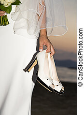 Bridal shoes - View held by the bridal shoes bride with...
