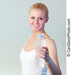 Portrait of a woman holding a bottle of water focus on woman