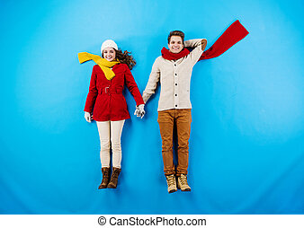 Winter couple blue background - Young couple in winter...