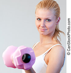 Close-up of a beautiful woman trained with weights focus on woman