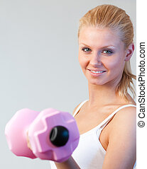 Close-up of a friendly woman trained with weights focus on woman