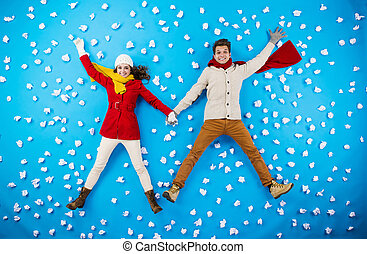 Young couple in winter studio having fun