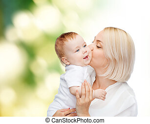 happy mother kissing smiling baby - family, child and...