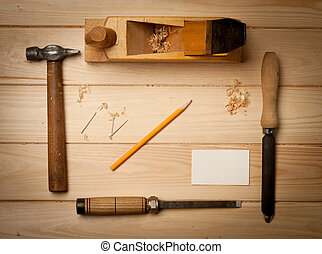 joinery tools on wood table background with business card...