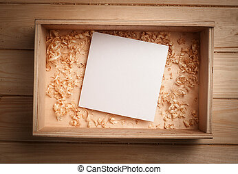 Empty wooden box with blank paper and copy spase