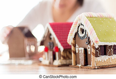 close up of woman making gingerbread houses - cooking,...