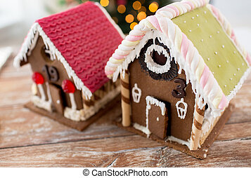 closeup of beautiful gingerbread houses at home - holidays,...