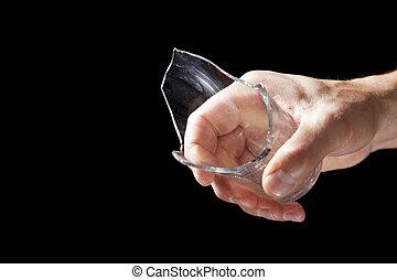 Broken drink glass in hand
