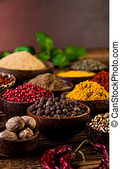 Spices in wooden Indonesian bowls - Traditional oriental...
