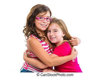kid girls tender hug smiling ans friends cousins on white...