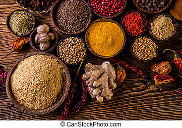 Variability of Asian spices on wooden table - Traditional...