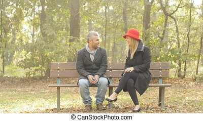 couple laughing having fun - happy adult couple talking...