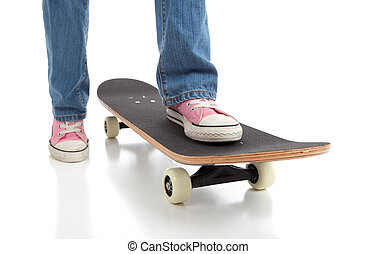 Skateboarding with Pink Shoes - A girl wearing pink...