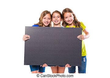 happy kid girls holding black board copyspace