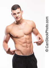 Shirtless muscular man pointing his six pack - studio shoot