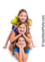 Three kid girls friends happy stacked in a row portrait on...