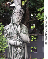 Quan Yin Statue in Japanese Garden with Maple Trees