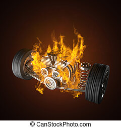 burning car chassis with engine and wheels