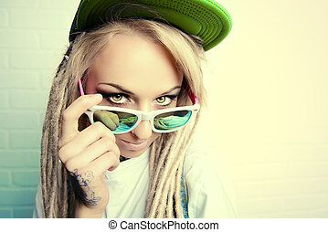 fanciful - Modern teenage girl with blonde dreadlocks...