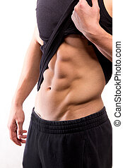 Muscular fitness man torso with six-pack - studio shoot