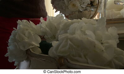 Florist decorates hall with white flowers - View of florist...