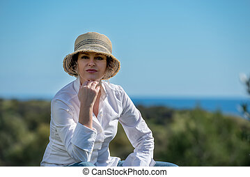 Woman  in hat in nature