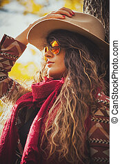autumn fashion woman outdoor - young woman wearing hat,...