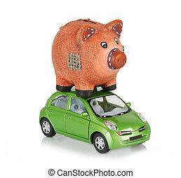 Small car with piggy bank on the roof - Small green car with...