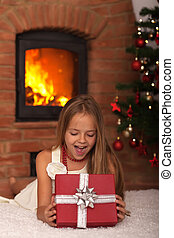 Little girl opening Christmas present