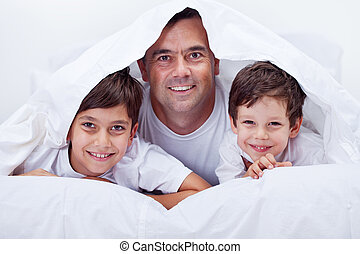 Father and his sons spending some lazy time together
