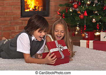 Kids opening their Christmas present