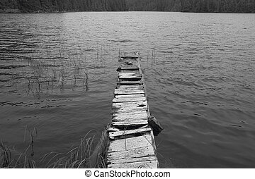 Wooden abandoned dock in a lake. Vancouver. Canada