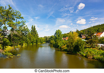 Small housing estate on the river bank in the sunny summer...