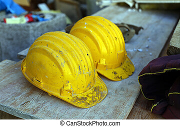 yellow helmets - two yellow helmets on work place