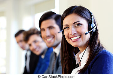 Cheerful young businesspeople and colleagues in a call...