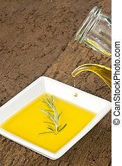 Glass jar pouring virgin olive oil