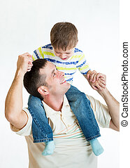 kid boy riding dad's shoulders isolated on white