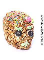 Candy skull - Closeup of honey covered cereal candy skull...