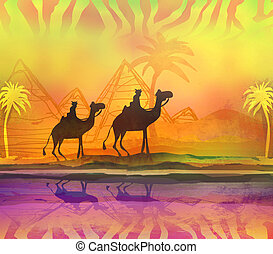 Camel train silhouetted against colorful sky crossing the...