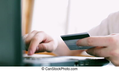 Man is using credit card for online payment - Man is using...