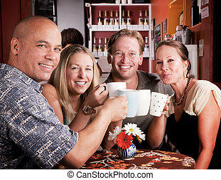 Toasting with Coffe Cups - Friends in a coffee house...