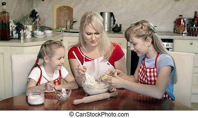 Adding Eggs to Dough - Little girls learning to make dough