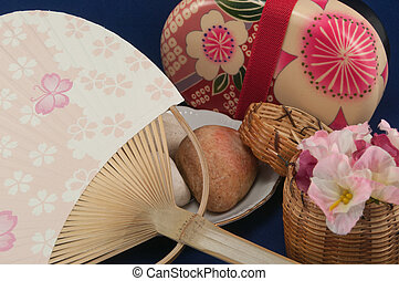 Asian Inspiration - Asian fan with smooth rocks a wicker...
