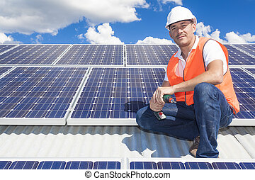 Solar panels with technician - Young technician installing...