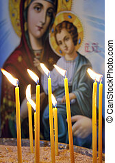 Candles in a Christian Orthodox church - Lit candles in a...